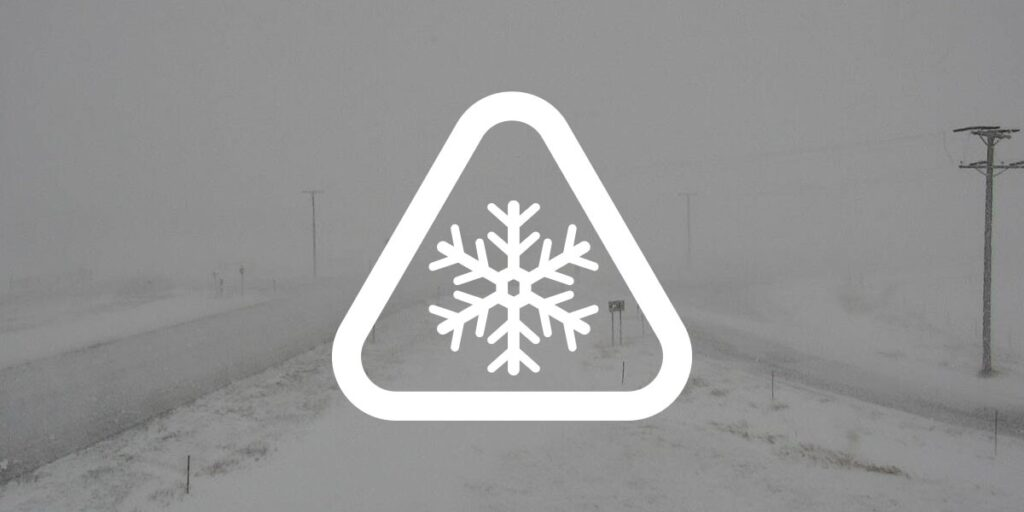 weather alert using a snowflake and caution sign